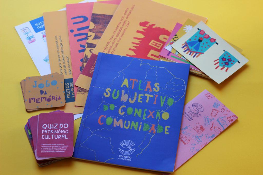 kit completo de materiais impressos do Conexão Comunidade